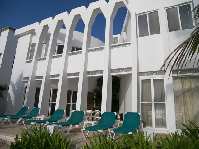 Villa Dos Jaguares. Back side view. Lounge chairs to get a rest